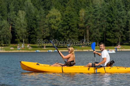 on pond young couple sitting in