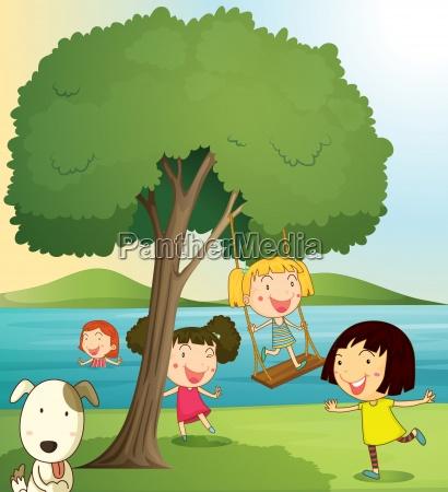 girls playing under tree