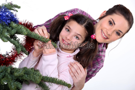 young woman and little girl near