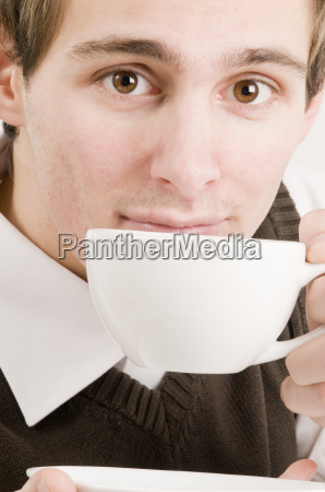 man with cup of coffee cut