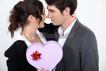 couple holding heart shaped box of