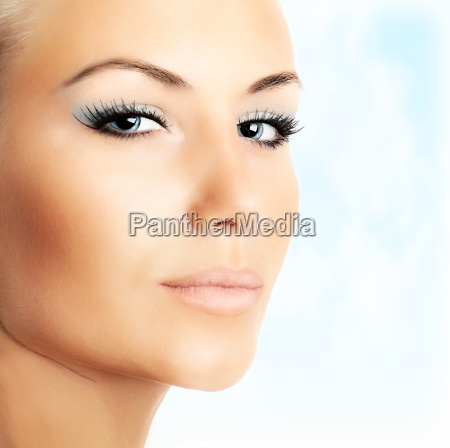 beautiful female face over abstract blue