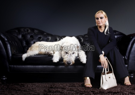young woman with dog on leather