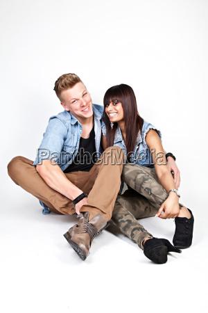 happy couple wearing jeans