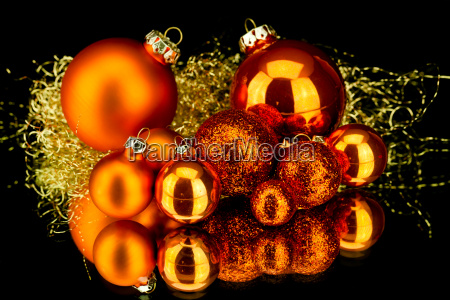 weihnachtsdekoration kugeln in orange rot matt