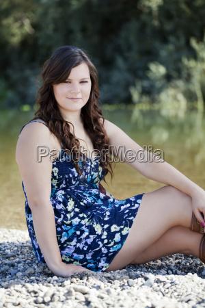 young plump caucasian woman outdoors dress