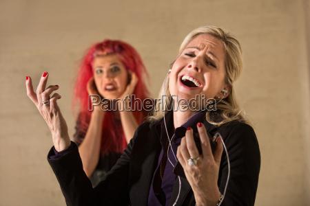 happy woman singling aloud