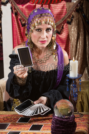 woman dealing tarot cards