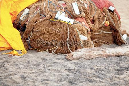 covering the fishing nets under tarpaulin
