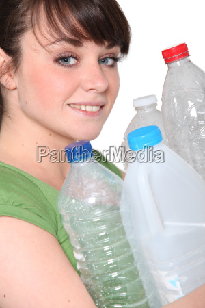young woman taking out the recycling