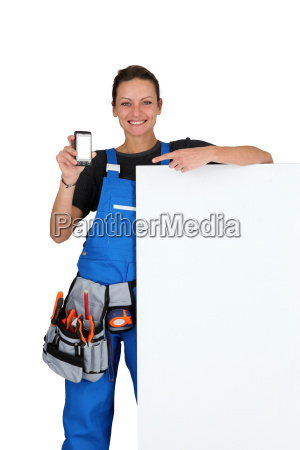young female laborer with smartphone