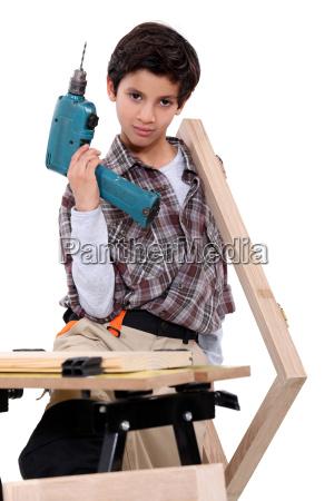little boy dressed like a craftsman