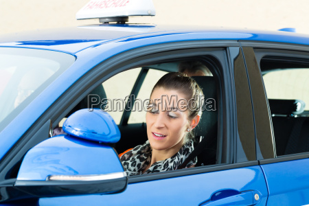 young woman in a driving school