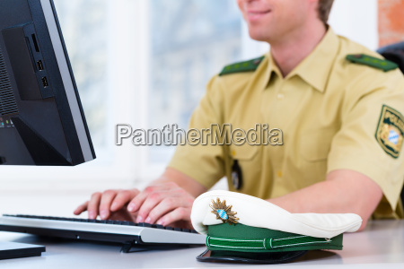 policeman at desk