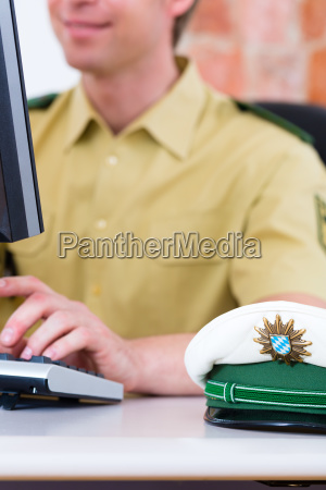 policeman at the desk