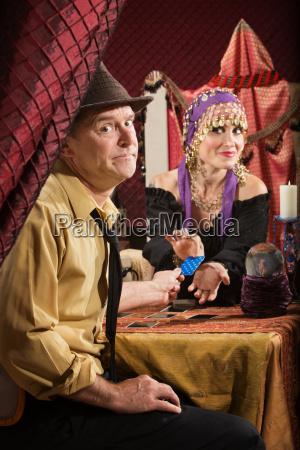 man paying fortune teller