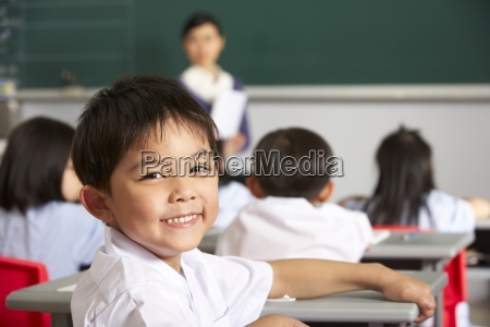 portrait of male pupil working at
