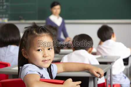 portrait of female pupil working at