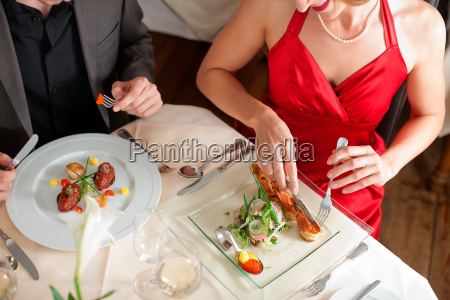couple eating and drinking in very