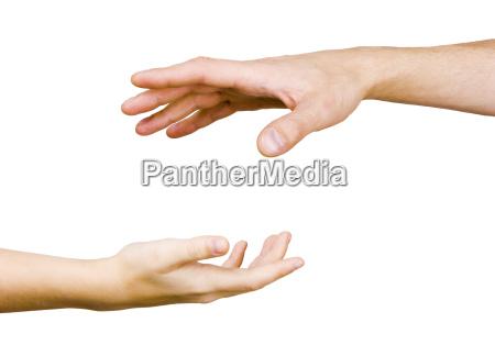 kinderhand greift nach der hand der