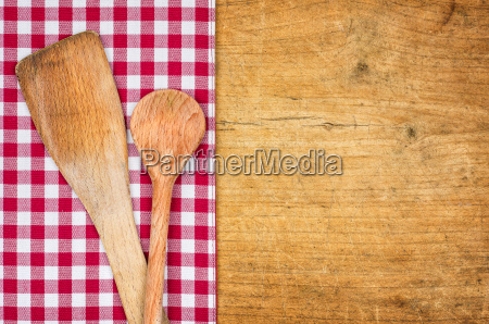 rustic wooden background with checked tablecloth