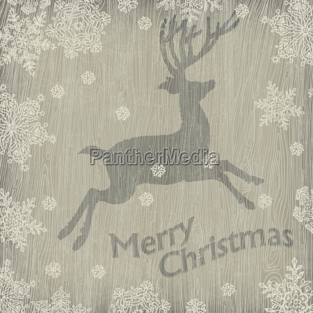christmas deer with snowflakes on wooden