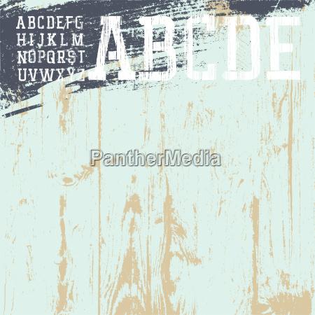 grunge alphabet with wooden background ready