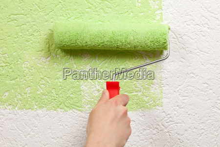 painter painting a wall with paint