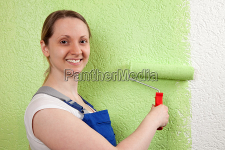 young woman with paint roller