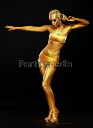 radiance fantasy golden woman performing in