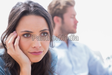 thoughtful woman holding her head next