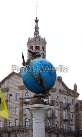 blue terrestrial globe sculpture kiev