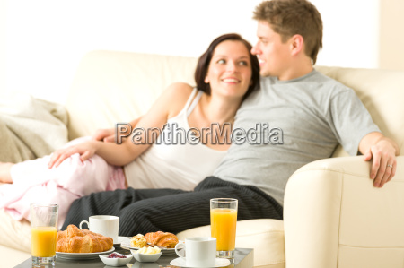smiling couple eating breakfast on their
