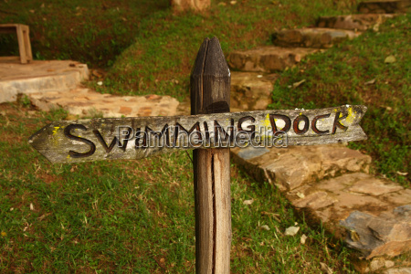 wooden swimming dock sign