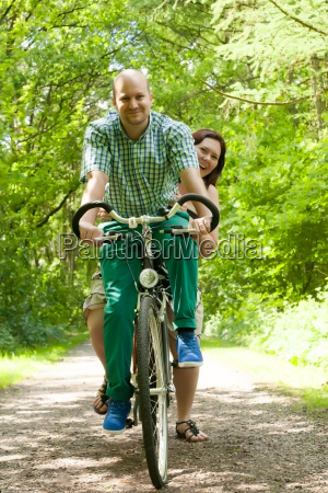 married couple on a bike