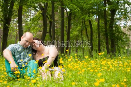 happy lovers in a buttercup field
