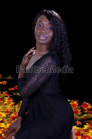 african american woman kneeling lingerie autumn