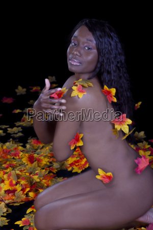 african american woman kneeling nude autumn