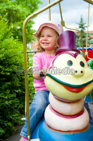 little girl on carousel