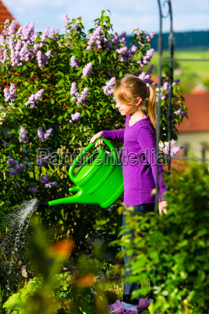 happy child pours flowers in the