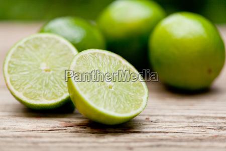 fresh green limes macro close up