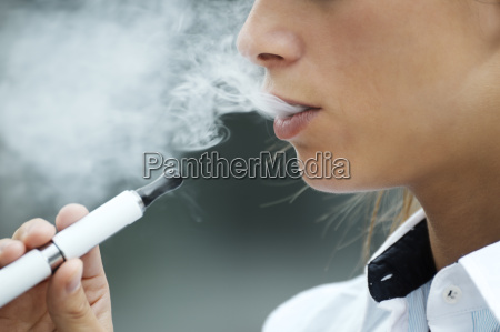 closeup of woman smoking electronic cigarette