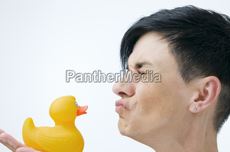 woman kiss the rubber duck