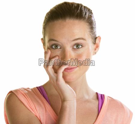 blushing young woman