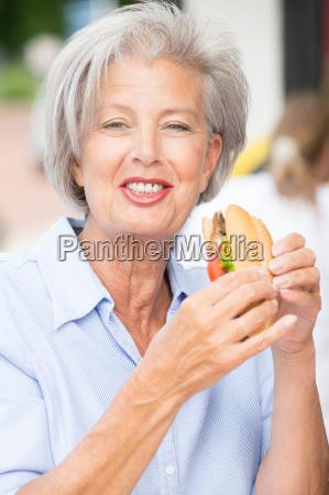woman eating fish bun