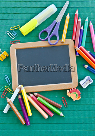 small blackboard with bueroutensilien