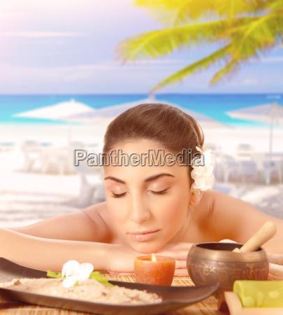 pretty woman enjoying massage on the