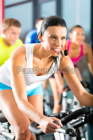 people at spinning in a gym