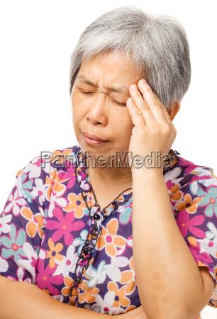 reife asiatische frau fuehlen kopfschmerzen