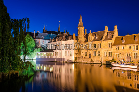 bruges canal at night and medieval